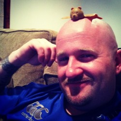 My hubby with a bear on his head