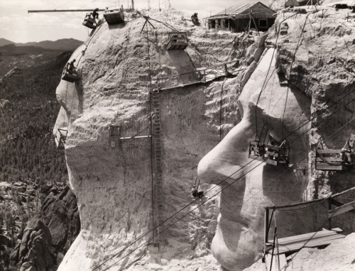 "natgeofound:  Thomas Jefferson at Mount Rushmore under construction, 1939. Learn more about the making of Mt. Rushmore.Photograph by Edwin L. Wisherd, National Geographic  ""I had rather be shut up in a very modest cottage with my books, my family and a few old friends, dining on simple bacon, and letting the world roll on as it liked, than to occupy the most splendid post, which any human power can give."" —Thomas Jefferson to Hugh P. Taylor, October 4, 1823"