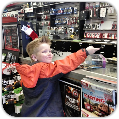 Nathaniel and Caleb received a gift card for GameStop from their cousin in South Carolina, so this most definitely had to be the FIRST place to do the damage on Christmas!  My boys get their love for video games from their Dad and they could literally buy everything in this store and be the happiest kids on the planet.  Your dad was a sucker for video games back in the 80's when Mario first came out.  It's awesome to see how that character (27 years later) is still around and you're playing the games.   Here's Caleb so proudly ready to give the cashier his gift card for his purchase.  Haha.