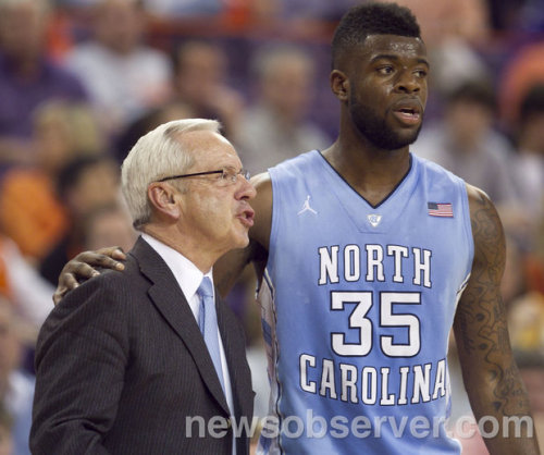 UNC's Reggie Bullock (35) confers with head coach Roy Williams