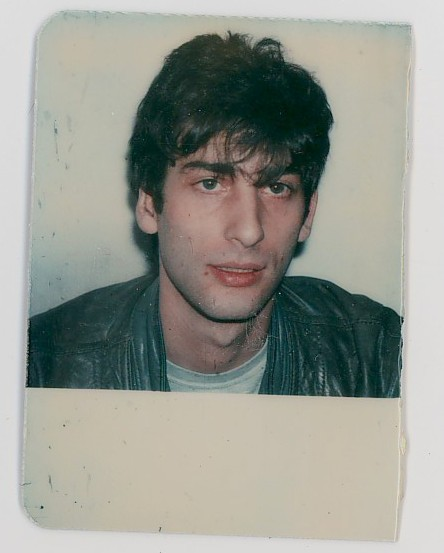 neil-gaiman:  There aren't a lot of photographs of me aged 23 as a starving young journalist in London. But I just noticed that I had this in the office here, and scanned it from my British Library Reading Room card. I was not even wearing black yet. Even the leather jacket was grey.