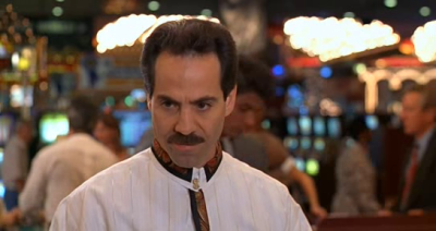 YFW the blackjack dealer from Austin Powers is the Soup Nazi.