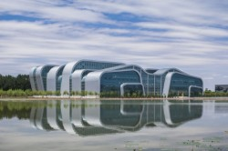Zhongwei Cultural Complex by Ho & Partners Architects in Zhongwei, China.Huge cultural building that not only tries to be visually exciting but also resembles the surroundings and the local art characteristics.May sound like a cliché, but China is just an exciting place to be architecturally, nowadays. Fresh ideas and grandiose constructions - new grounds.
