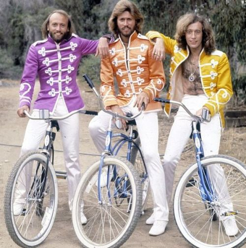 ridesabike:  Barry, Maurice and Robin Gibb ride bikes.  A+, though Robin could have maybe buttoned his jacket.
