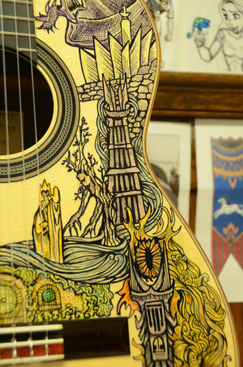ianbrooks:  LOTR Illustrated Guitar byVivian Xiao Exquisitely detailed enough to be crafted in the forest realm ofLothlórien, this beauteous guitar was not forged by elf nor man, but by 16 year Vivian Xiao with sharpie markers! Depicting Nazgul, Minas Tirith, and even the all-seeing Eye of Sauron, this divinely-engraved instrument could surely inspire even more Led Zeppelin songs. Check put Vivian'swebsitefor details on purchasing andcommissions.  Artist:Deviantart/Tumblr/ Facebook(via:Obvious Winner)