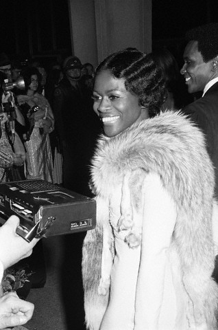 "vintageblackglamour:  Cicely Tyson answers a reporter's questions on the red carpet as she arrives at the #Oscars on March 27, 1973. Ms. Tyson was nominated in the Best Actress category for her role in the film, ""Sounder"". She and Diana Ross made history that year as the first Black actresses nominated in the Best Actress category in the same year (Liza Minnelli won for her role in ""Cabaret""). I am not sure if he was with Ms. Tyson that evening, but Dance Theater of Harlem founder Arthur Mitchell is to her right in this picture. Photo: Frank Diernhammer/Conde Nast Archives."