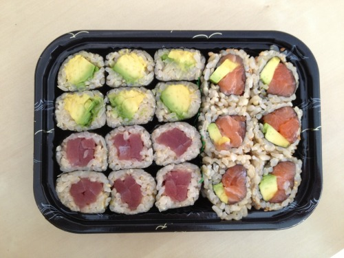 LUNCH.  Avocado roll, tuna roll and salmon avocado roll.