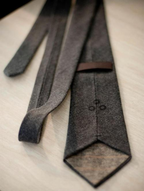 handsomebeastj:  Charcoal Herringbone Wool Tie. I'm a fan of the logo and the tie keeper.Haven't had a chance to knot it myself, but am thinking of ordering one from the fine folk over at R. Perkins. Will definitely review it if I get the chance to.