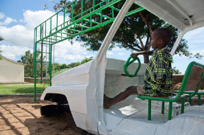 An empty lot near a hospital in Malawi has been transformed into the country's first playground for disabled children, with play equipment made from recycled materials—including—appropriately for the location—an old ambulance. Dutch designers Luc van Hoeckel and Pim van Baarsen turned the ambulance, found in a junkyard, into a playhouse. Other scrap material, like car tires, axles, and springs, were also turned into new equipment with the help of Sakaramenta, a local social enterprise that also makes bicycle carts. Their goals: to make something simple, strong, and sustainable.   via Playground for Malawi Children's Hospital Built Around Upcycled Ambulance | Sustainable Design on GOOD)