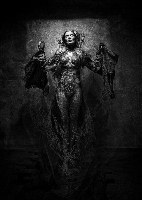 frozen in time witchy statuesque dark armor magic stone black magic statue reliquary gravestone effigy