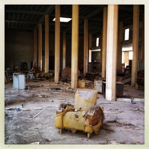 An armchair sits in the abandoned Palais du Justice building in Dakar, Senegal in February 2013. Photo by Jane Hahn @janehahn #dakar #senegal #iphoneonly #architecture