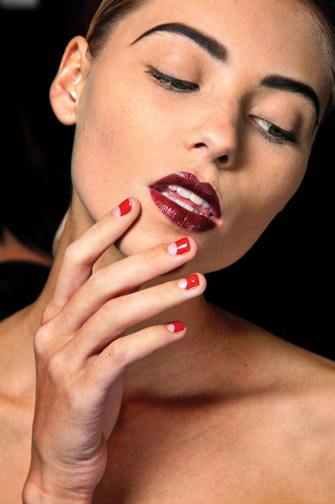 This cherry red half-moon mani is one of our favorite nail ideas for spring.