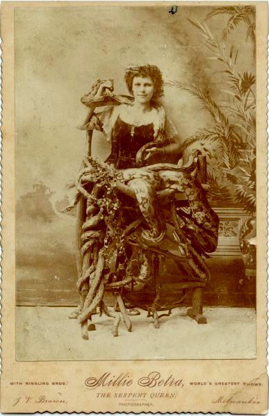 "ca. 1885, [cabinet card portrait of Millie Betra,""The Serpant Queen"", of the Ringling Bros.], Brown via  Syracuse University Library, Special Collections Research Center, Ronald G. Becker Collection of Charles Eisenmann Photographs"
