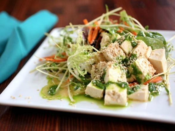cookingchannel:  This Tofu Salad With Chive-Ginger Oil is packed with enough protein to make it a filling main dish. Leftovers, if there are any, are brown-bag worthy, but keep the dressing on the side and add if before you eat so the greens don't get soggy. Click here for this Meatless Monday recipe!