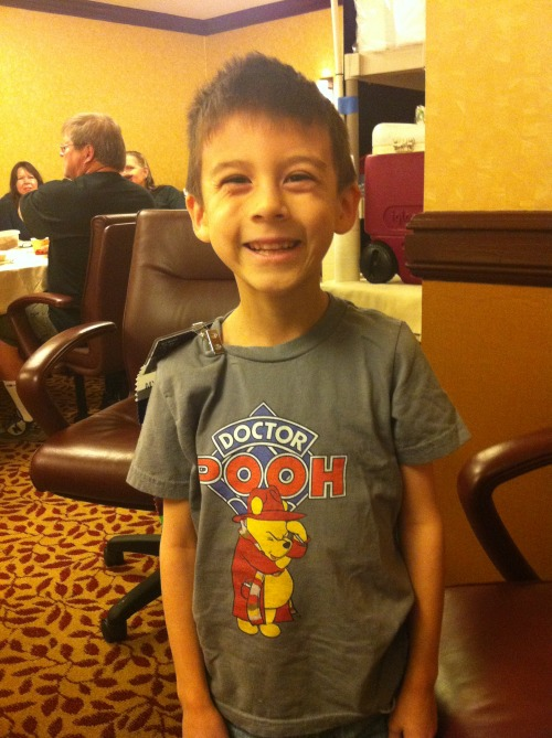 "dark-wesley:  wiccabuffy:  My son wearing ""Doctor Pooh"" at #Gally1  That's my boy :) Tee by Redbubble, if anyone was curious.  Looks great. Love the choice of shirt colour. Thanks for buying."