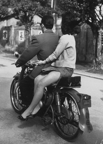 theniftyfifties:  A couple on a motorcycle in Taipeh, China, 1959. Photo by John Dominis.