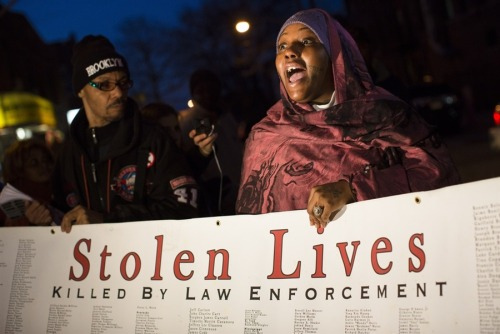 "politics-war:  Demonstrator Fatimah Shakur speaks during a vigil held for Kimani ""Kiki"" Gray in the East Flatbush neighborhood of Brooklyn on March 13, 2013, in New York. The 16-year-old was shot to death on a Brooklyn street last Saturday night by plainclothes police officers who claim the youth pointed a .38-caliber revolver at them."