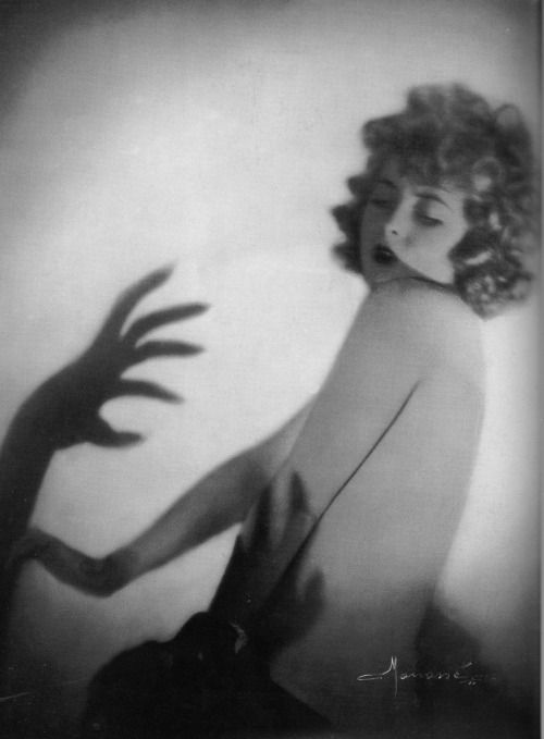 black-celluloid:  Studio Manasse c.1920s , I love how this image has a German Expressionist feel to it, with the long stretched out shadows on the unsuspecting heroine. taken from Divas & Lovers, photographic fantasies from Vienna between the Wars