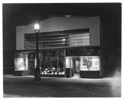 losangelespast:  An Art Deco building with a book store open for business late at night, Weyburn Avenue in Los Angeles, 1938.