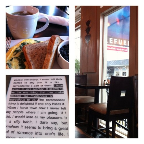 Rainy breakfast reading.  (at Refuel)