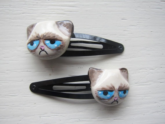 aprilfoolromance:  Just ordered Grumpy Cat hair clips from tinytangerines.etsy.com :3