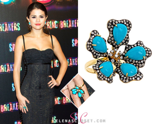 "Selena Gomez stepped onto the red carpet premiere of ""Spring Breakers"" in Madrid sporting some turquoise jewels. She wore a J Hadley Turquoise Flower Ring, which can be yours for a hefty $3,250.00. Buy it HERE She wore this ring with her Dolce & Gabbana dress, Casadei Heels and Dana Rebecca earrings."