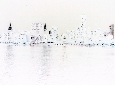 nyc skyline at night, colors inverted.  the dark spots are the light.  the black dot on the top left-ish is not a spot on your screen; that is jupiter.