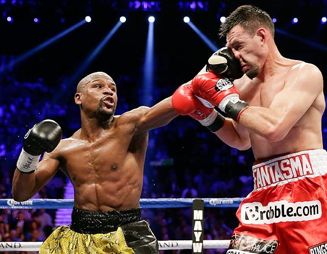 Floyd Mayweather lands a left jab to the face of Robert Guerrero during Saturday's fight in Las Vegas. Mayweather won by decision. (AP) GALLERY: Mayweather Defeats Guerrero