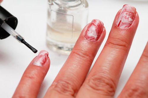 Marble Nails, using water!  http://www.wikihow.com/Create-a-Marble-Nail-Effect-Using-Water