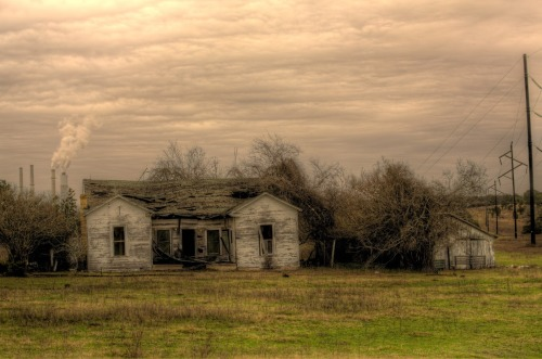 … On our way back to Houston, I had to stop again at this old farm house, if only long enough to take a few pictures. I decided to include the power plant in the background and I'm so glad I did. The new perspective hives it a completely different aspect. Taken in Fayette, TX. Click here to see the same farm house taken by my old CyberShot about six months ago: Old Abandoned Farmhouse - When children's voices called, Where grasses now stand still  Follow Highly Defined Reality on Facebook