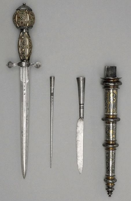 art-of-swords:  Dagger Set Unknown Artist / Maker Dated: circa 1600 Culture: German Mediul: Steel, silver, gold and antler, false-damascened and inlaid Measurements: Length: 23.7 cm, blade; width: 2 cm; weight: 0.225 kg Inscription: 'I I H I N I N'  Source & Copyright: The Wallace Collection