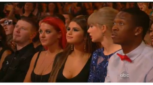 selgomez-news:  Selena during the speech of Justin.  Yea dude next to Taylor Imma need you to move and Charity Imma need you to move to where the dude is so Justin can sit down next to Selena. Thank you