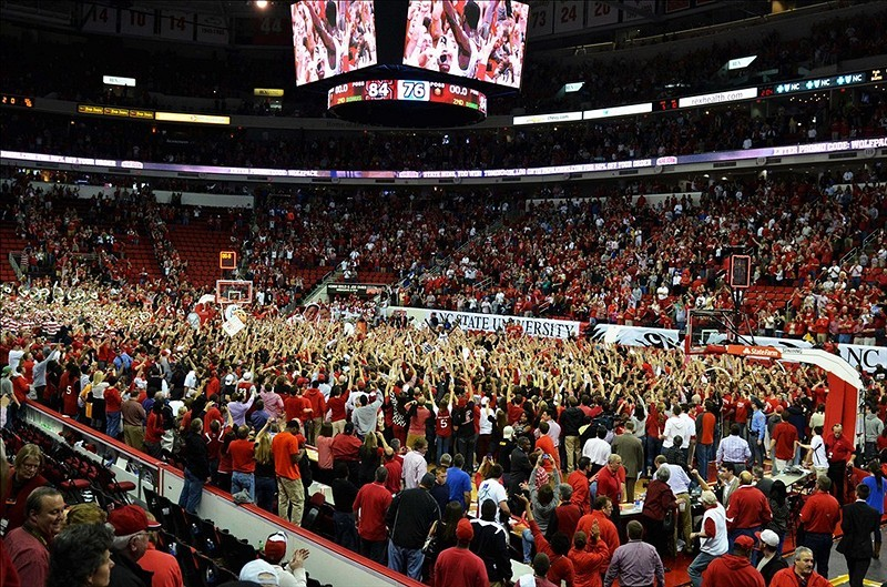 North Carolina State fans (including one in a wheelchair!?!) rushed the court to celebrate a win over No. 1 Duke.