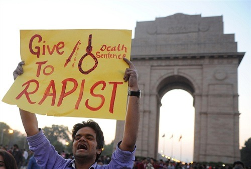 "Indian gang-rape victim's condition deteriorating, hospital says The condition of a 23-year-old Indian medical student, whose gang rape in New Delhi triggered nationwide protests, has deteriorated and there are signs her vital organs have failed, the Singapore hospital treating her says.Reuters reports that family members ""have been informed that her condition has deteriorated and they are currently by her side to encourage and comfort her,"" Mount Elizabeth Hospital Chief Executive Officer Kelvin Loh said in a statement.Photo: Indian students and activists carry signs at India Gate during a protest following the gang-rape of a student in New Delhi on Dec. 19, 2012. (Sajjad Hussain / AFP - Getty Images)"