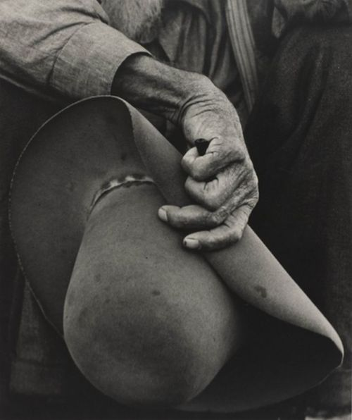 lovelyydarkanddeep:  dorothea lange, worker's hand and hat. 1938