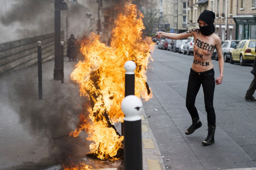 "Members of Ukrainian feminist group Femen staged protests across Europe as they called for a ""topless jihad."""
