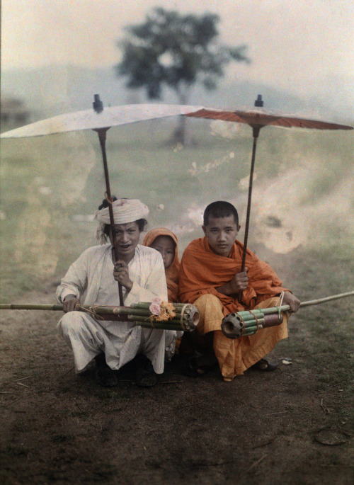 "Shan man and two priests prepare to set off bamboo rockets in rain, Myanmar, November 1931. Photograph by W. Robert Moore, National Geographic  ""rockets in rain"""