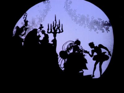 rc-vrj:  Lotte Reiniger (1899 - 1981) is a German Silhouette Animator who made many films of Fairy Tales, including Snow White and the Seven Dwarves, Puss in Boots, Sleeping Beauty and Cinderella. The above image is taken from an Animation made in 1922, about Cinderella (Aschenputtel). Her work is very well made, fine and intricate paper cuts are used against a scene to create a flowing but some-what jolty and mesmerising animation. Considering there are no clear faces or clear ways of depicting emotion in the animations, there is an obvious sense of narrative and characters are very emotive.