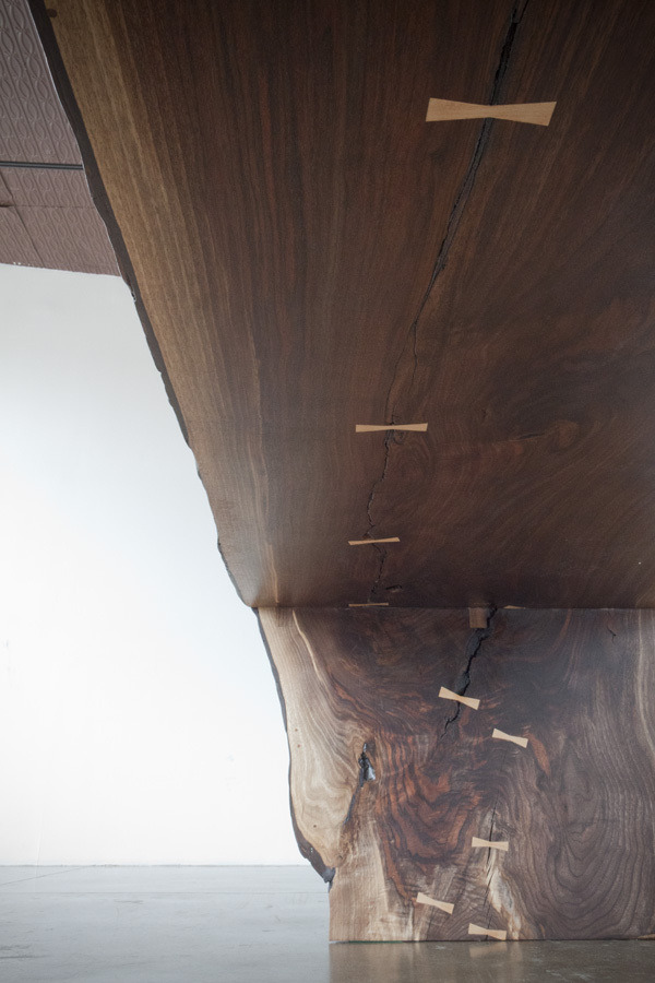 Walnut Waterfall Table, Bronze Trestle Base | Michael Wong | Archinect