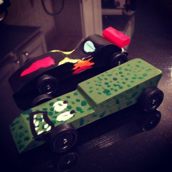 Pinewood derby cars, ready to race tomorrow night. on Flickr.I've determined that the only factors relevant to speed for this derby are wheel alignment and weight. The axle attachment to the car body is a complete crapshoot - very difficult to ensure alignment beyond the first run. Of course axle lubrication is important but it's a level playing field cause everyone will do that. I've read all sorts of discussion about weight placement but have had the best results by drilling weight rods into the rear of the car, then topping off weight at check-in with sticky weights on the underside. My guess is that Jo's car (green) will perform better, but I've been wrong before!