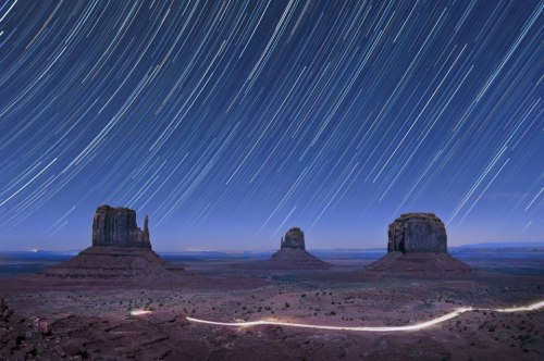 Star trails over Monument Valley, Utah. See all things to do outdoors in Utah.