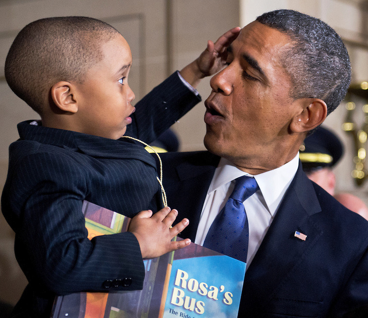 brooklynmutt:  FEBRUARY 27: President Barack Obama holds Terrell Anderson Jr., 3, of Detroit, a relative of Rosa Parks, after a statue unveiling ceremony for the civil rights activist in the Capitol's Statuary Hall. (Photo By Tom Williams/CQ Roll Call) (via Rosa Parks Statue | CQ Roll Call)