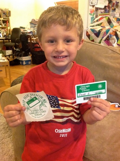 His First Library Card! Today we see Zane with his first library card (and an appropriate shirt for the upcoming Memorial Day). Congratulations Zane, and welcome to Chicago Public Library! HIP HIP HOORAY!