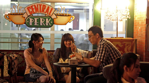 "wildthicket:  ""Central Perk, the fictional coffee shop where the characters of Friends spent almost all their time, has finally opened in real life. A near-identical replica of the iconic '90s hangout has opened in a Beijing apartment complex, run by a Friends superfan named Du Xin. His intense devotion to Friends is apparent from the detail Du put into his Central Perk, which has the same window and doorway as the ""real"" coffee shop, as well as that couch. Furthermore, the menu only features snack items mentioned on the show, complete with annotations that explain exactly when that cupcake appeared in an episode. Du has even constructed a replica of Joey and Chandler's apartment next door to Central Park, featuring a foosball table, Baywatch DVDs, and the giant TV cabinet Joey built."" (Eric Thurm for A.V. Club)  this is too cool"