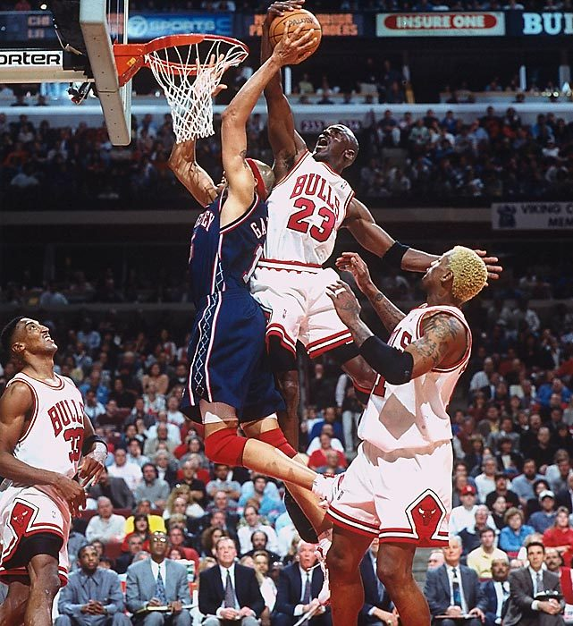 Michael Jordan rejects the New Jersey Nets' Chris Gatling at the rim in Game 1 of an Eastern Conference playoffs first-round series in 1998. With Jordan scoring 32 or more points in each game, the Bulls made quick work of the Nets, eliminating them in three games. (John Biever/SI) GALLERY: SI's 100 Best Michael Jordan Photos
