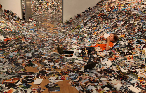 minusmanhattan:  Photography In Abundance by Erik Kessels. This is an installation shot of Erik Kessel's show of every photograph uploaded on Flickr over 24 hours.