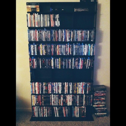 Finally got a shelf for all my movies! First row is box sets, seconds row is for Criterion Collection films, next few rows are Blu-rays and the bottom rest are dvds and tv shows. Ignore the stack of movies to the right. Those are extras for my brother.