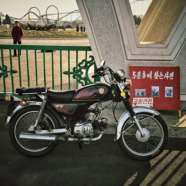 North Korean traffic police have gorgeous motorbikes. I want one this beautiful .  (via Photo by dguttenfelder • Instagram)