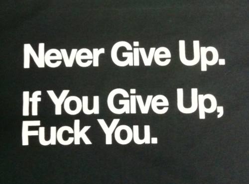 "liefplus:  the ""Never give up"" shirts now exist!! printed on non-sweatshop shirts, in HELVATICA :) these will ship in a week or two, order it now to secure the size u want!!! thank u so much freinds for suporting me, i love u verymuch and 2013 is gona be the biggest year for boosting and alt positivity,and im hapy this shirt can be a symbol and an icon of that  The ""Never give up"" shirts now exist!!!                   Yes the original post showed only two exclamation points. Upon debate the editors here at Beach Sloth solemnly agreed the third exclamation point was necessary. New Steve Roggenbuck shirts are the Hess Trucks of Alt Lit. While there may not be any lights or anything there is the sense of pure uncut positivity. Steve Roggenbuck has rocked and cocked this great nation of America. America is so excited and now there's absolutely no way to hide. For Steve Roggenbuck wants America as he sleeps on floors, eats college food, and encourages people to ""Never Give Up"".                   What does the shirt really represent? Not since 'i was ok in the sea put me back' has there been this positive jubilation about Steve Roggenbuck's shirt style brand. Recently Beach_Sloth (the twitter handle) tweeted 'i was ok in the internet put me back' in support of this courageous method. Yet this new shirt is far more optimistic. Whereas Steve's previous statement indicated a sort of 'anti-evolutionary' stance via the first fish that grew a pair and walked shore, this one states that those who try will succeed. Life is about failure. Most of life is made up of failure. Those successes, those sweet succulent tidbits of success are made sweeter by failure.                    Lots of people exist right now on Earth trying to make their dreams happen. Most of them are doing it in non-alt lit ways. For some people success means a window office. Others mean raising a successful family. Successes are like snowflakes: no two are alike. Also like snowflakes successes can be fleeting and melt on the tongue. Yeah success is a buxom beast ready to get down and dirty with its good self. But it is also a snowflake. Nobody can define success quite the same way. Like porn, somebody knows success when they see it.                   The last part 'if you give up fuck you' shows the loneliness at giving up the dream. It is important to keep on trying. At some point fate will say 'Oh why not' and throw a couple of twenties down on the ground to help somebody out. At some point a poem will be accepted into a prestigious journal. At some point what was considered impossible will become possible. Success does take time. However success is not purely reliant on fate. Success requires people to keep on working at their dreams. While the dreams may change and the goals may change the success will still feel the same. As somebody puts on one of these bad boys from the Terrific Tumblr Titan Steve Roggenbuck it helps him achieve his dream, just a little bit. Piece by piece, little by little, everyone will be successful at different times and different paces. This is the beauty of life. Drink it up. Obey your life."