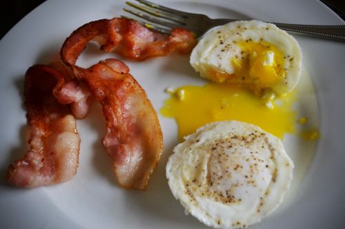 breakfast. keepin' it simple.two poached eggs and three pieces of bacon. i ate one piece before i snapped the picture :)